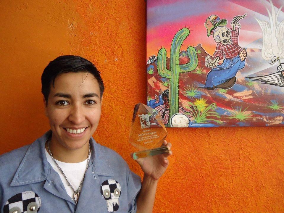 Mel w/award